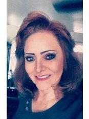 Dr Elizabeth Salinas - Dentist at Peña Reyna Dental Care
