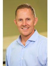 Dr Cary Brown - Dentist at Center FOR ceramic dental implants