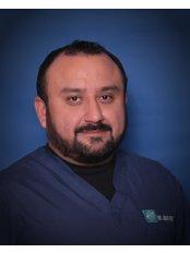 Dr. Juan Trejo DDS - Dentist at American Bio-Dental Center