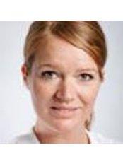 Dr E. Numan - Dentist at Kliniek Voor Cosmetische Tandheelkunde Amsterdam Zuid