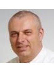 Dr Ralph van der Reijden - Dentist at Tandheelkundig Centrum Wilhelminapier