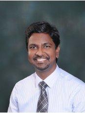 Dr Naveen Kumar  C - Orthodontist at Kenz Dental & Orthodontic Centre