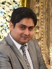 Orthozone Dental Surgery - Dr. Junaid Israr