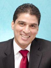 Dr Juan Carlos Moreno - Principal Dentist at Just Smile Dental Clinic