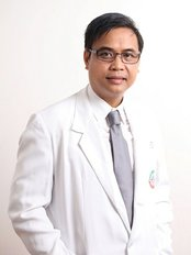 Dr Daniel Farnacio - Oral Surgeon at Dwell Dental Wellness Philippines