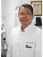 Dr Alberto Banaag - Dentist at Bel-Air Dental Care