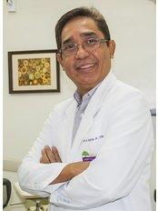 Dr Anselmo Tripon Jr - Dentist at Bel-Air Dental Care