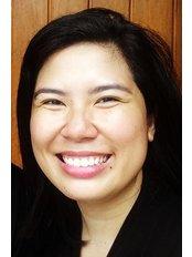 Dr Cecilia Flores - Dentist at Flores Dental Makati City