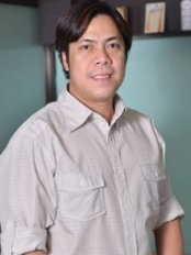 Dr Randy Ortiz - Dentist at Oasis Dental Care-Bago Bantay
