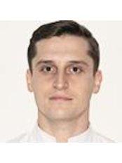 Mr Mariusz Spruce -  at Pod Szyndzielnia Dental Clinic