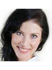 Dr Catherine Becker -  at Pod Szyndzielnia Dental Clinic