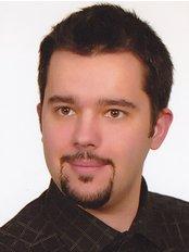 Dr Tomasz Piekarz - Dentist at Prywatna Przychodnia Stomatologiczna ComfortDent