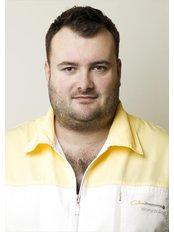 Dr Bartosz Cichon -  at Cichon Implant Dental Clinic Krakow