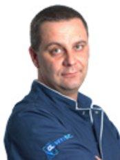 Dr Mariusz Piotrowski -  at Globus s.c