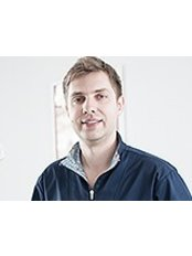 Dr Aleksander Tarnawski -  at Royal Dental