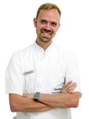 Dr. Mariusz Bolzan - Zahnarzt - Platek Zentrum für Zahnmedizin und Schönheitspflege