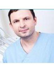 Dr. LUKE Pawlaszek - Zahnarzt - Dentaurus Zahnklinik - Toruń