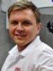 Dr. Slawomir Kwiecinski - Geschäftsführer - FabDent
