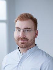 Dr. Jan Lyczek - Kieferorthopäde - Dental Corner