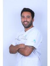 Dr Ronite Harjivan -  at Previdente Dental Clinic