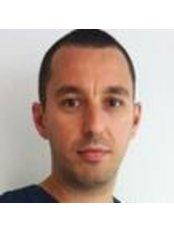 Dr Alexandru Darie - Dentist at Dental Garant