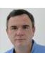 Dr Oleg Dobrovolschi - Dentist at Dental Med Com