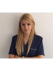 Dr Raluca Cosmoiu - Dentist at Dridih Dent