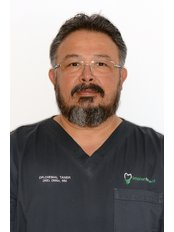 Dr Taner Chemal - Principal Dentist at Implantodent Bucuresti