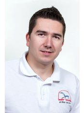 Mihai Varvara - Principal Dentist at Smart Dental