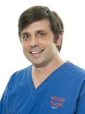 Dr Cosmin Fetcu - Principal Dentist at ARTEM DENTAL CLINIC