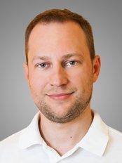 Dr Eugene Mamet -  at Group Clinics Center for Aesthetic Dentistry - Center for Implantology