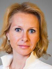 Dr Elena Germanovna Razuvaeva -  at Group Clinics Center for Aesthetic Dentistry - Center for Implantology