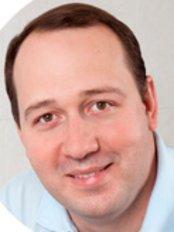 Dr Emil V. Krysanov - Dentist at Vit Art Dental Clinic