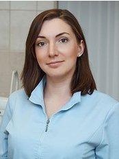 Dr Olga Assumption - Oral Surgeon at Art Dental