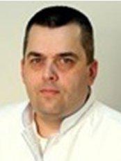 Dr Yury Frolov -  at Dental Clinic Radent in Ozerki