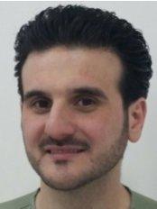 Dr Omar Hasan Achour - Orthodontist at Quality Dental Clinics-Jeddah