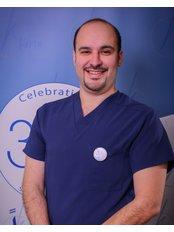 Dr. Mutaz Qutob - Orthodontist at Kharsa Ortho-Dent Center