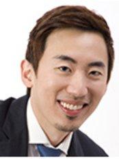 Dr Kenneth Tan Huan Kiat -  at Orchard Scotts Dental