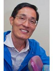Tan Tien Wang - Dentist at Smile Dental Group - East Coast
