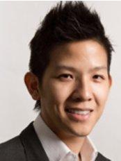 Dr Anthony Tay - Dentist at Caring Dental Sengkang