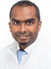 Dr Ashraf Ali - Dentist at Smilearts Dental Studio (HillV2)
