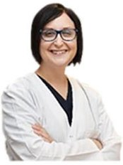 Dr Suzette Stander - Dentist at Implant Perio Inc - George