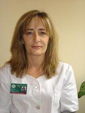 Dr Tina Cubero - Dentist at Dental Clinic Plaza Prosperidad
