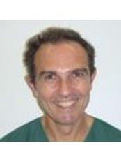 Dr Carlos Fabian Muzzupappa - Dentist at Centro Dental Milenium Barón de Pinopar