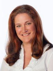Ina Althaus Bondulich Dentist -  at Clinica Dental Althaus & Bondulich