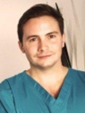 Dr Joaquín Guedón -  at Sigma Clínica Dental