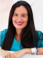 Dr Mª Dolores Huertas -  at Sigma Clínica Dental
