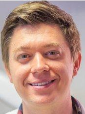 Dr Rodion Bushin - Dentist at Bushin Dental Clinic