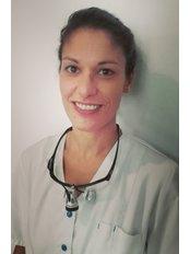 Dr KATHARINA  JOYA CHOWDHURY - Dentist at Clínica Dental Cots