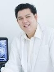 Dr Nathawut Sirisaowaluk - Orthodontist at Dr. Tooth Dental Clinic